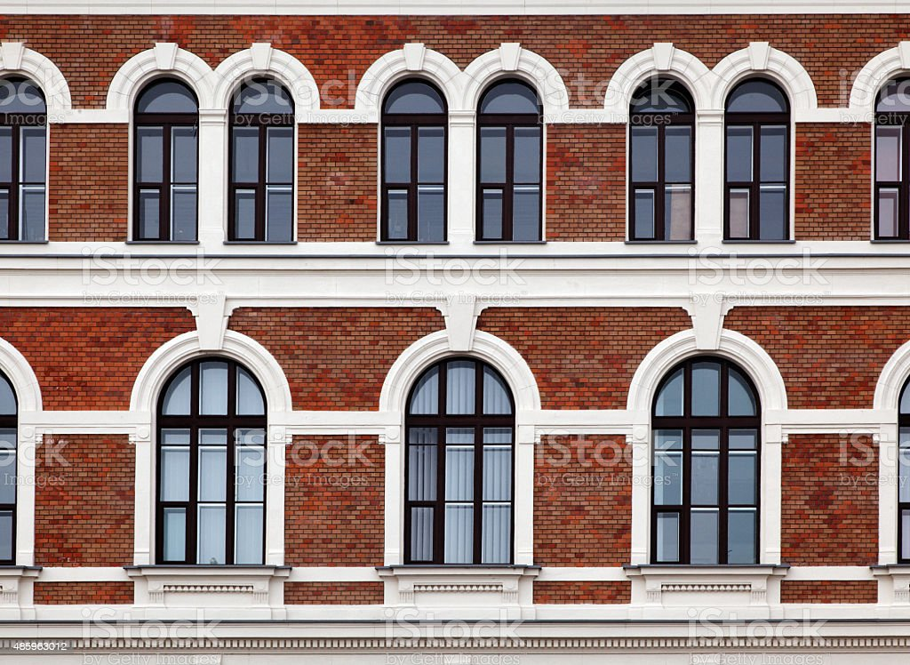 arched windows pattern on building facade with brick walls royalty free stock photo