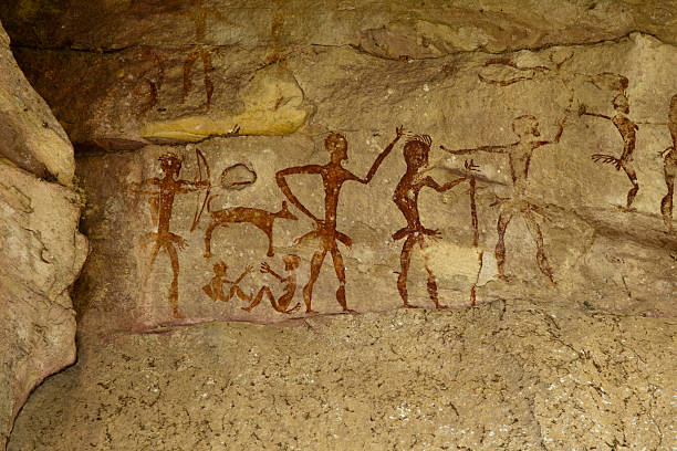 Archeological pre-historic human clift paint Archeological pre-historic human clift paint over 4000 years ago, Nakhonratchasima, Thailand. antediluvian stock pictures, royalty-free photos & images