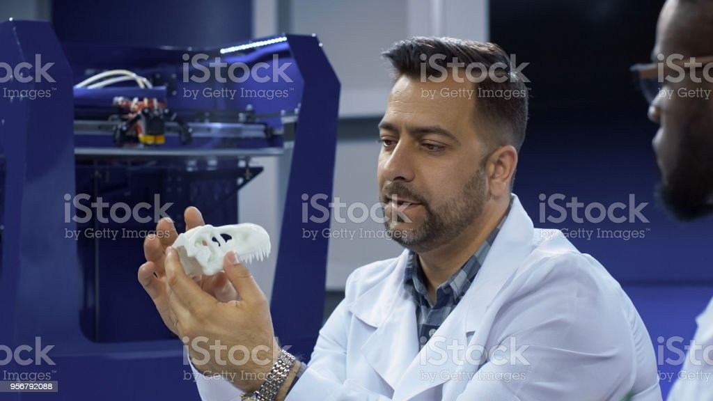 Archeologists working with 3-D printing stock photo