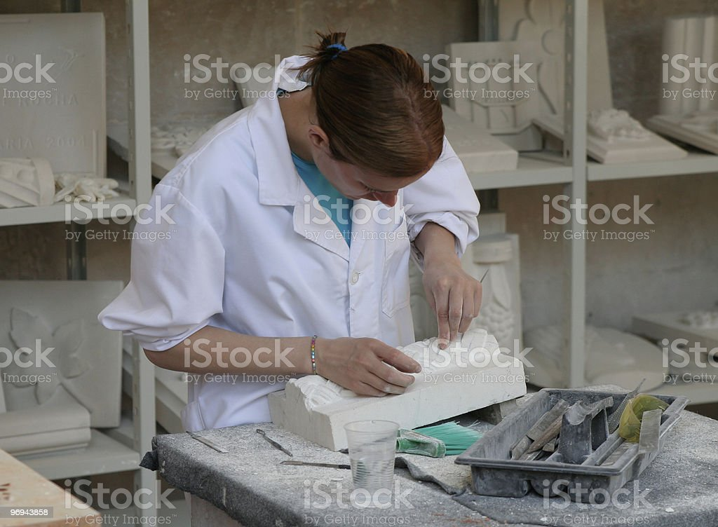 archeology student working on a relief royalty-free stock photo