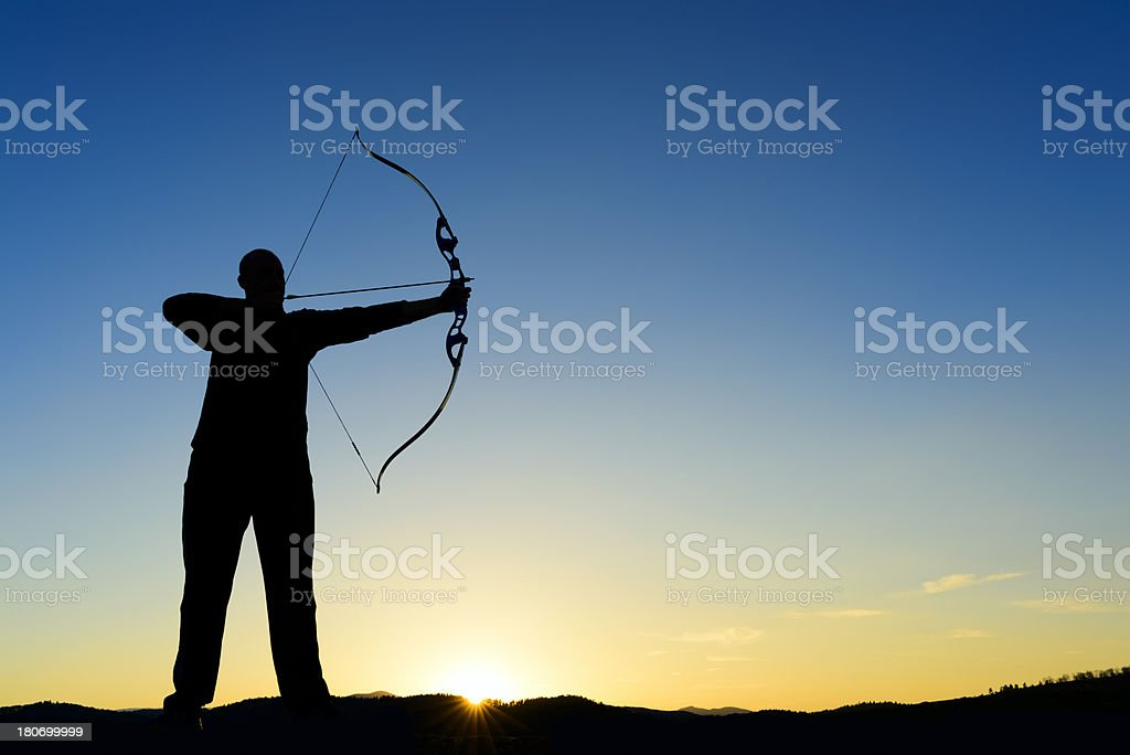 archer at sunset, silhouette stock photo
