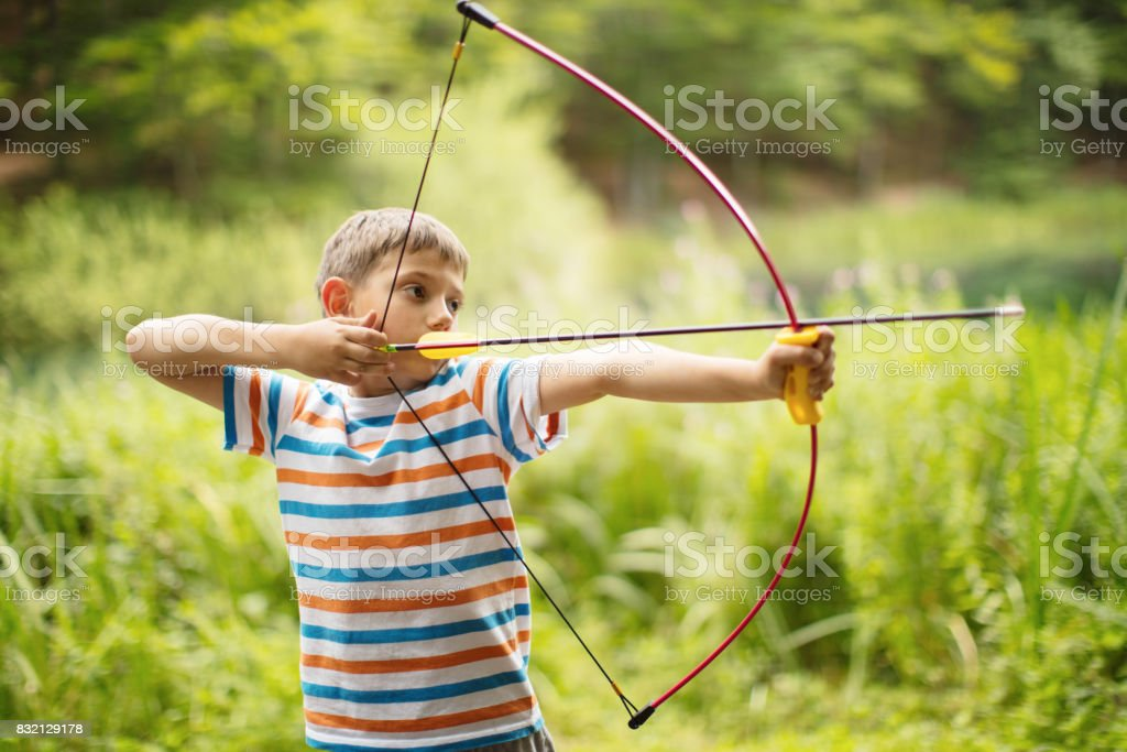 Archer boy in nature stock photo