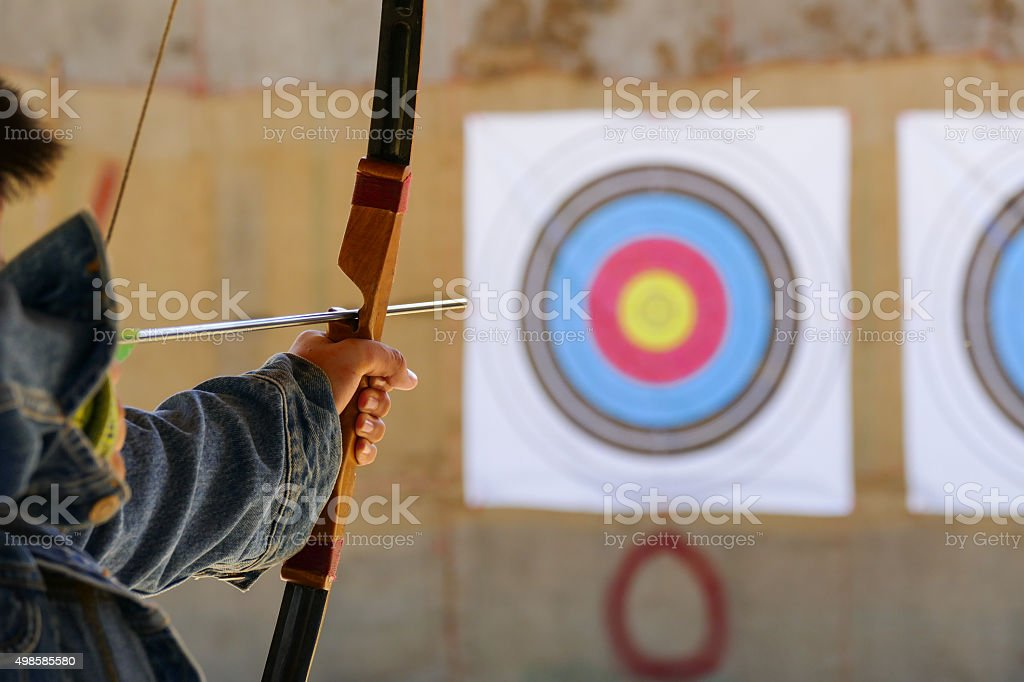 archer is aiming the archery at the target stock photo