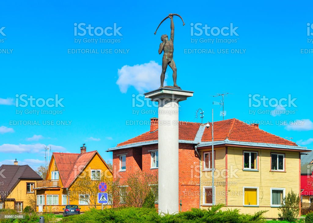 Archer sculpture at crossroads with rotary motion in Druskininkai stock photo