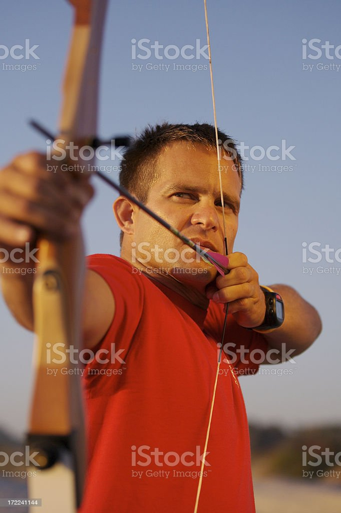 Archer series with man wearing red royalty-free stock photo