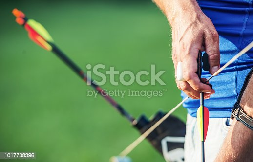 istock Archer. Sportsman practicing archery. Sport, recreation concept 1017738396