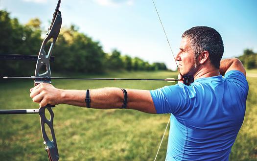 Archer Sportsman Practicing Archery Sport Recreation Concept Stock Photo - Download Image Now