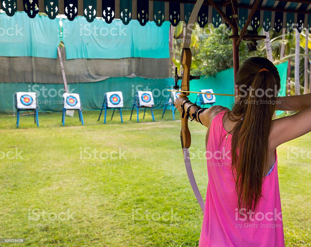 Archer takes aim at a target stock photo