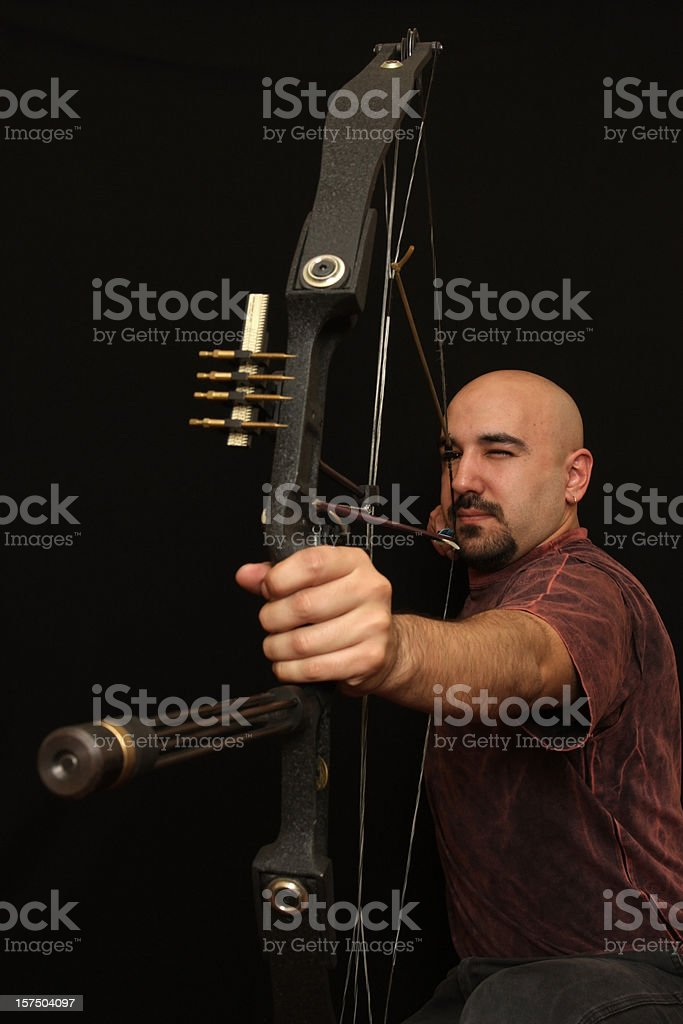 Archer with Bow and Arrow on Black Background stock photo