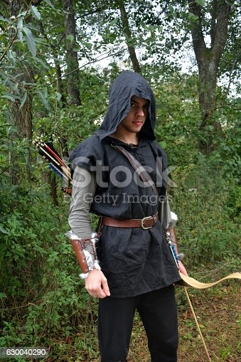 630040004 istock photo Archer with  coloured arrows in the quiver stands with bow 630040290