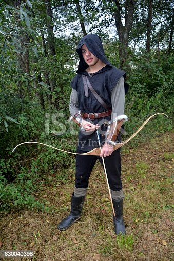 630040004istockphoto Archer with  coloured arrows in the quiver stands with bow 630040398