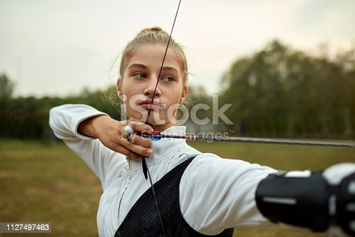 istock Archery Girl 1127497463