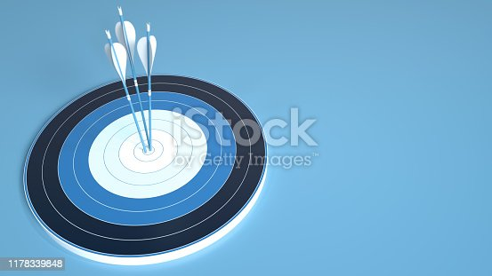 469652019 istock photo Archery target hit in the center by three blue arrows, isolated on blue background 1178339848