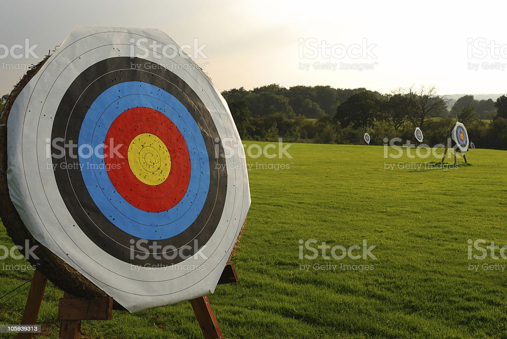Archery target in the foreground stock photo