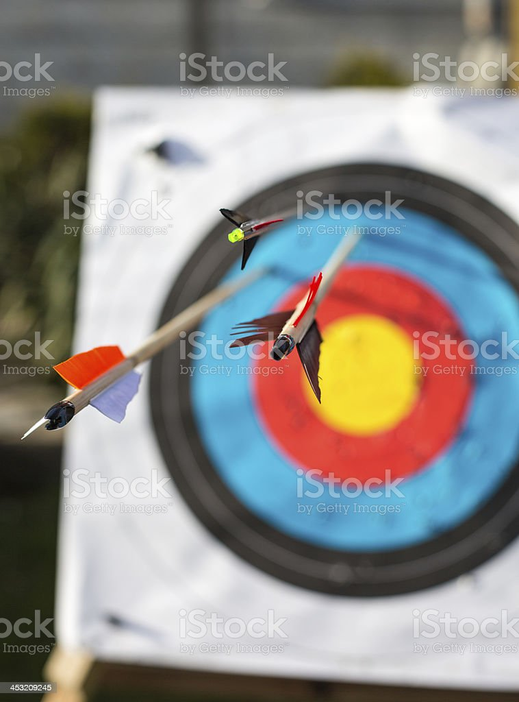 Archery target with arrows royalty-free stock photo