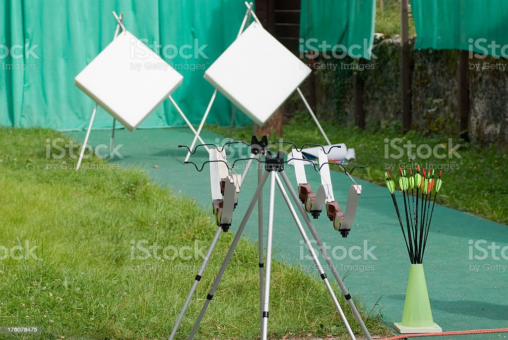 archery Trainingsstation with arrows and bows royalty-free stock photo
