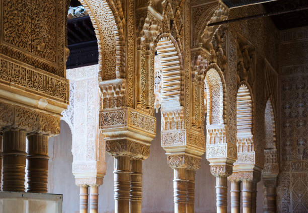Arches and columns of Court of the Lions  at Alhambra GRANADA, SPAIN - MAY 13, 2016: Arches and columns of Court of the Lions  at Alhambra in day time.  Granada palacios nazaries stock pictures, royalty-free photos & images