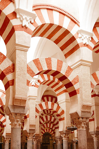 Arches and incredible architecture inside the Mezquita The Mezquita (Spanish for mosque) of Cordoba is a Roman Catholic cathedral and former mosque situated in the Andalusian city of Codoba, Spain cordoba mosque stock pictures, royalty-free photos & images