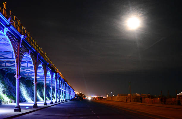 Arches and Moonlight on Brighton Beach stock photo