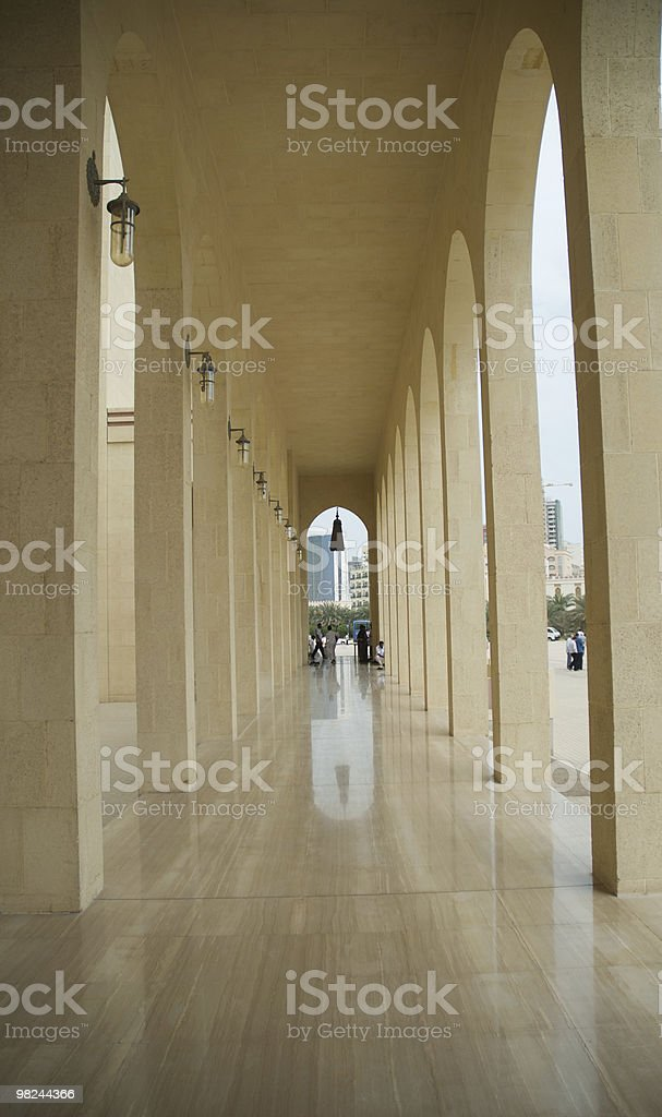 Arches in pathway of a mosque royalty-free stock photo