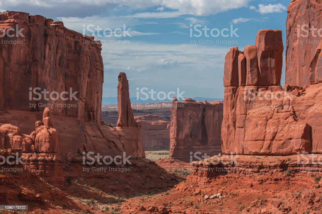 Arches National Park in Utah Arches National Park in Utah. Arches National Park lies north of Moab in the state of Utah. Bordered by the Colorado River in the southeast, it's known as the site of more than 2,000 natural sandstone arches, such as the massive, red-hued Delicate Arch in the east. Long, thin Landscape Arch stands in Devils Garden to the north. Other geological formations include Balanced Rock, towering over the desert landscape in the middle of the park. Arches National Park Stock Photo