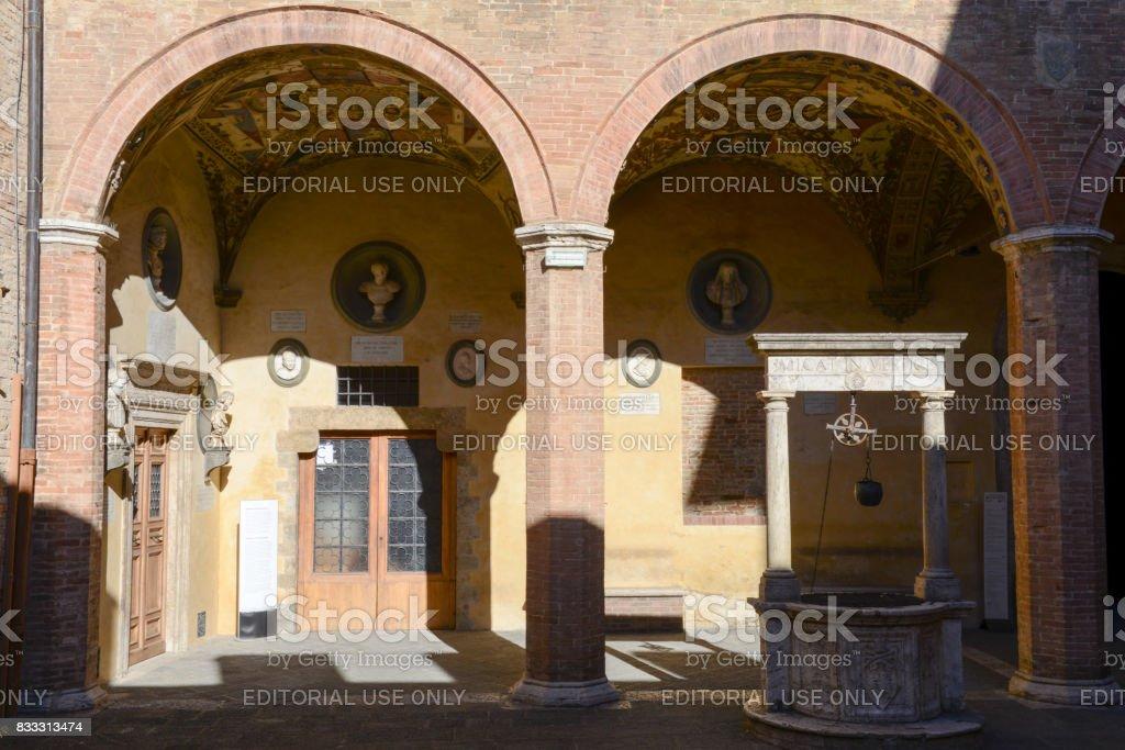 Arches of Chigi Saracini palace at Siena