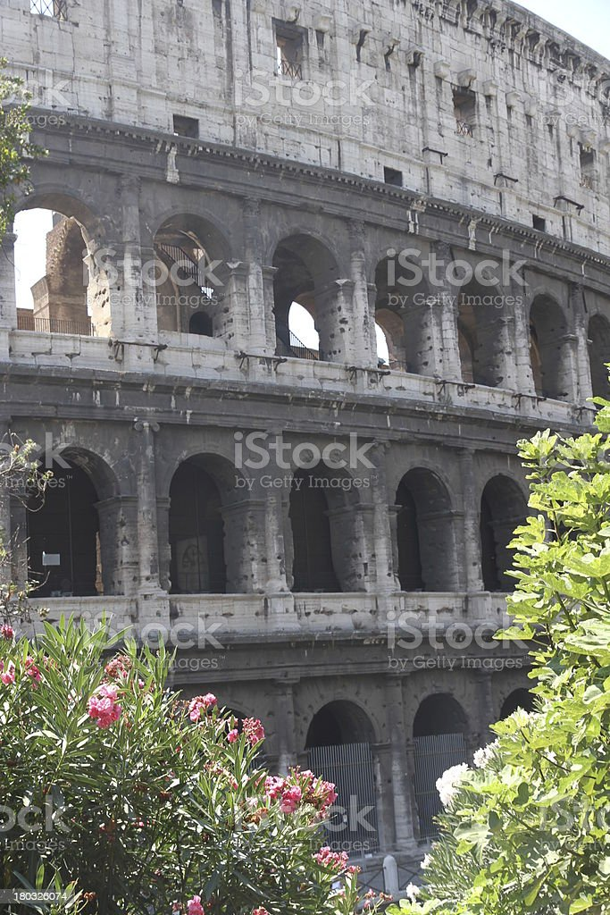 Arches of the imposing Colosseum stock photo