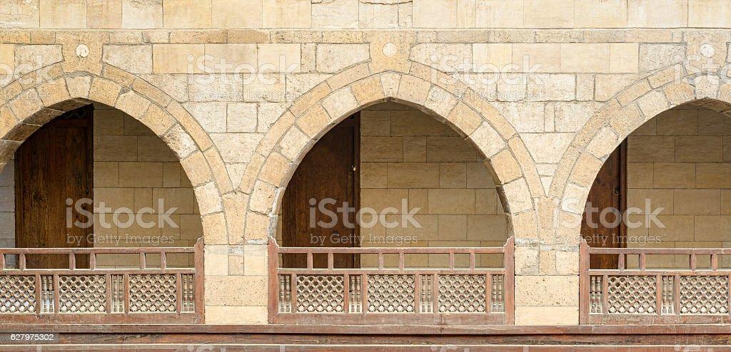 Arches with wooden balustrades, caravanserai (Wikala) of al-Ghuri, Cairo, Egypt stock photo