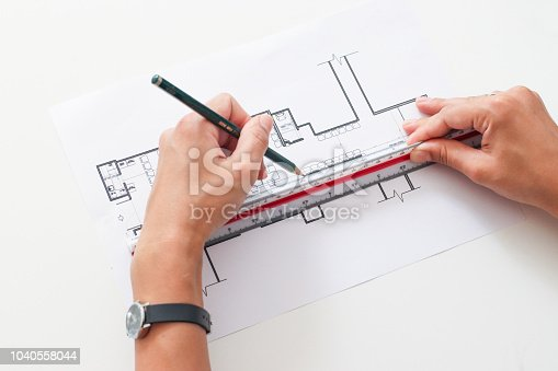 832105172 istock photo architect and an interior designer Drawing a plan 1040558044