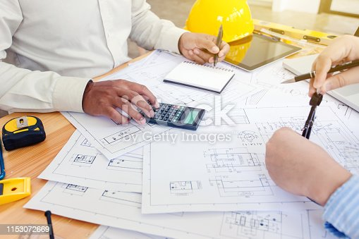1174841541 istock photo Architect and businessman meeting discuss a plan about the construction project of real estate. 1153072669