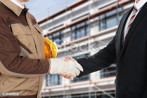 istock Architect And Businessman Shaking Hands 518494918