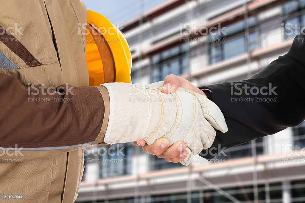 Architect And Businessman Shaking Hands stock photo