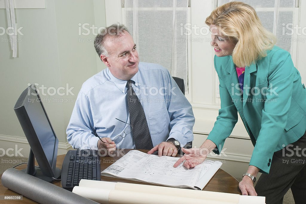 Architect And Client Looking At Blueprints 3 royalty-free stock photo