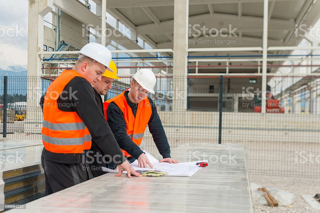 Architect and construction team stock photo