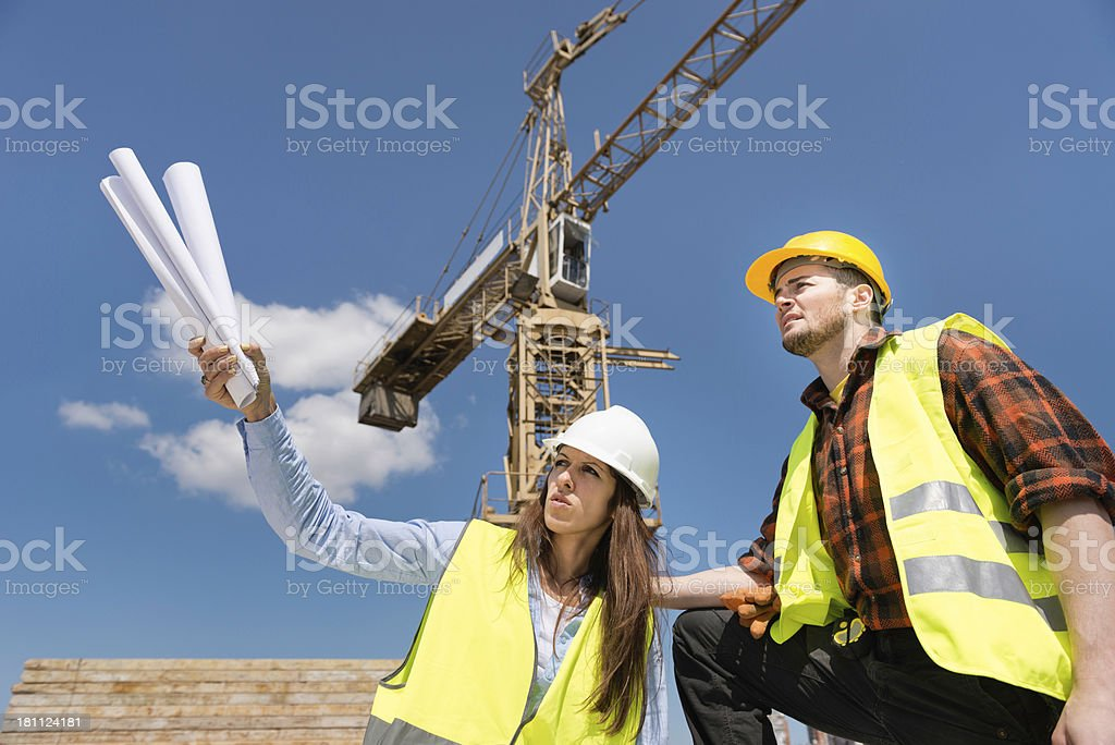 Architect and construction worker on site royalty-free stock photo