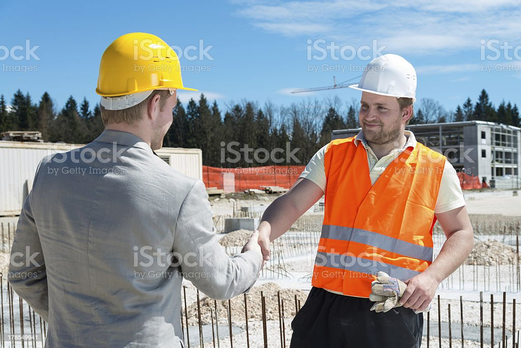 Architect and construction worker royalty-free stock photo
