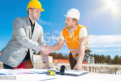 1071990712 istock photo Architect and construction worker shaking hands. 514730997