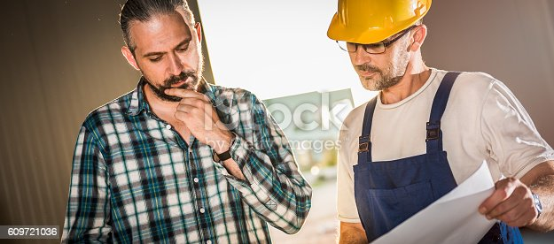 istock Architect and Construction workers checking checking Architectur 609721036