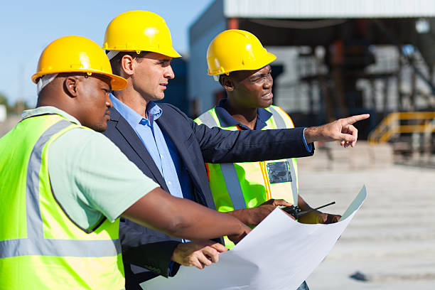 architect and construction workers stock photo