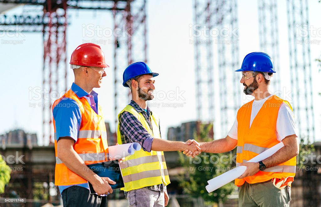 Architect and engineer handshake for successful project development stock photo