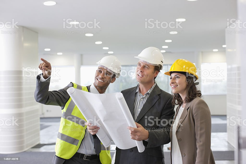 Architect and engineers with blueprint royalty-free stock photo