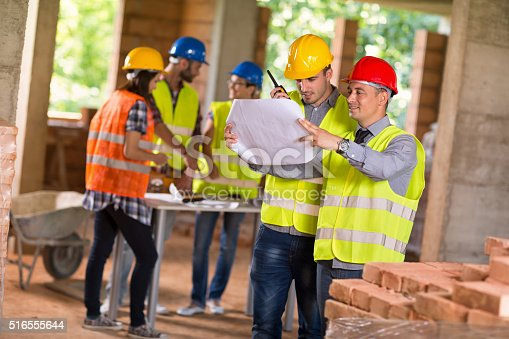 516607254istockphoto Architect and investiture consider possibilities at site 516555644