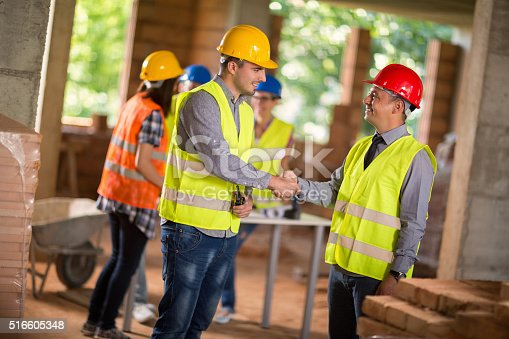 516607254istockphoto Architect and investiture make deal 516605348