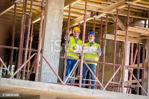 516607254istockphoto Architect and worker in building construction 516609468