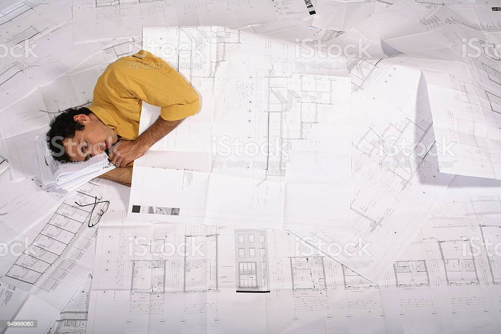 Architect asleep at the office royalty-free stock photo