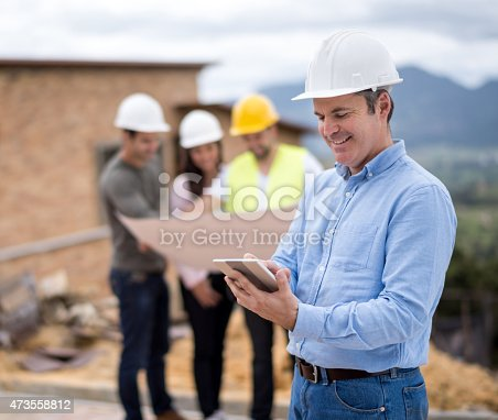 1054724700istockphoto Architect at a construction site 473558812