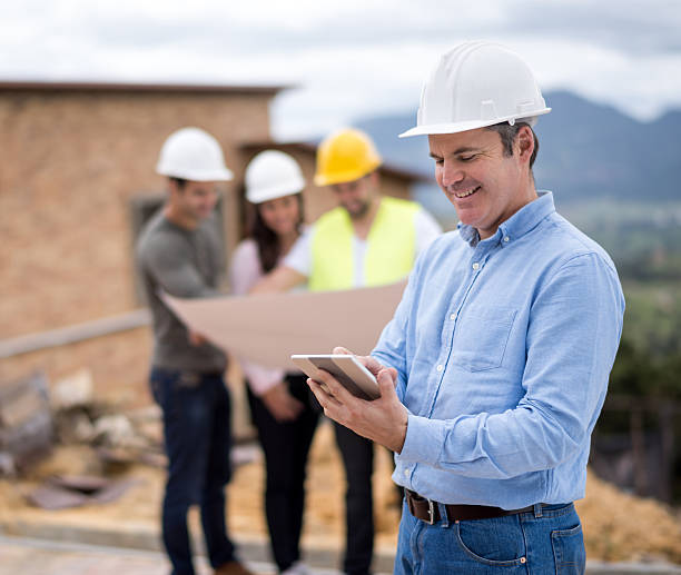 architect at a construction site - civil engineer stock photos and pictures