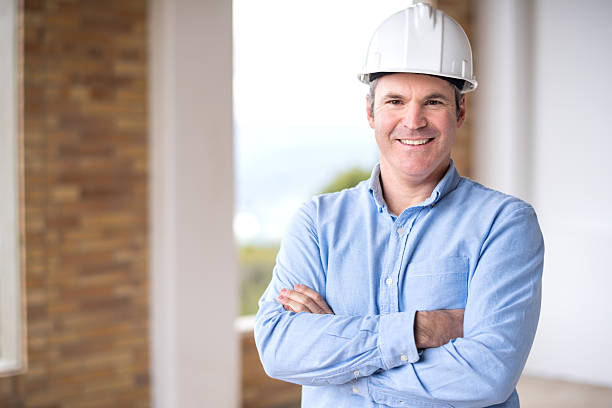 architect at a house under construction - civil engineer stock photos and pictures