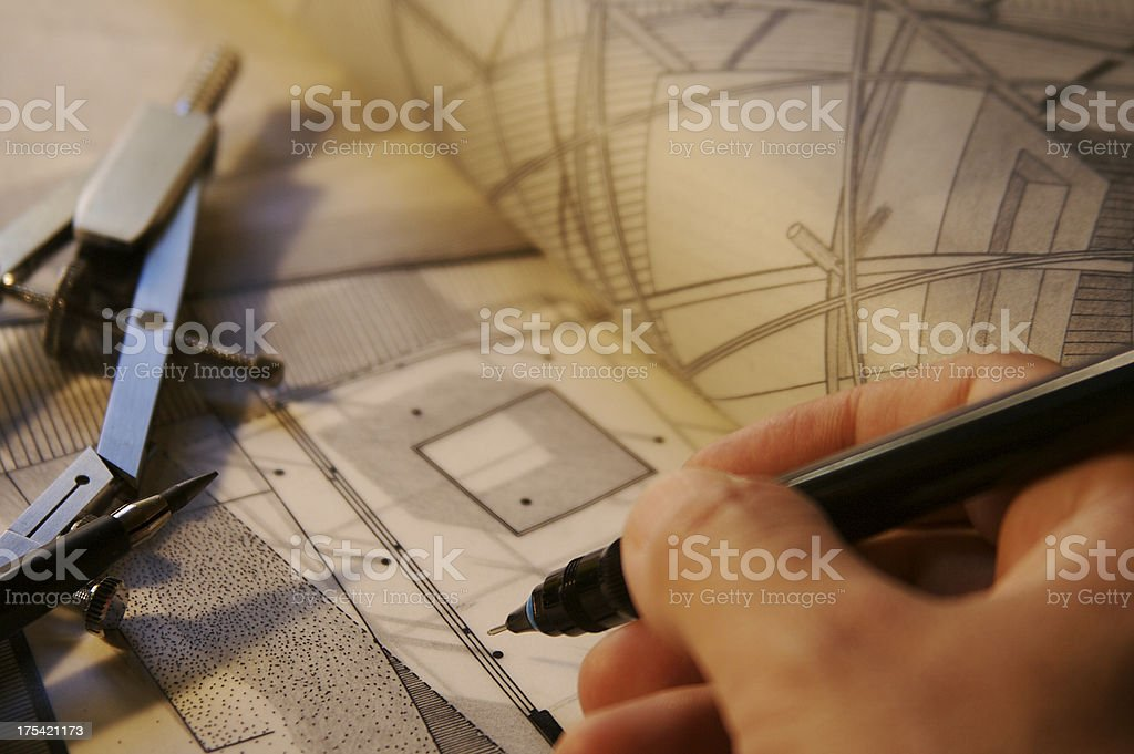 Architect at work drawing an house royalty-free stock photo