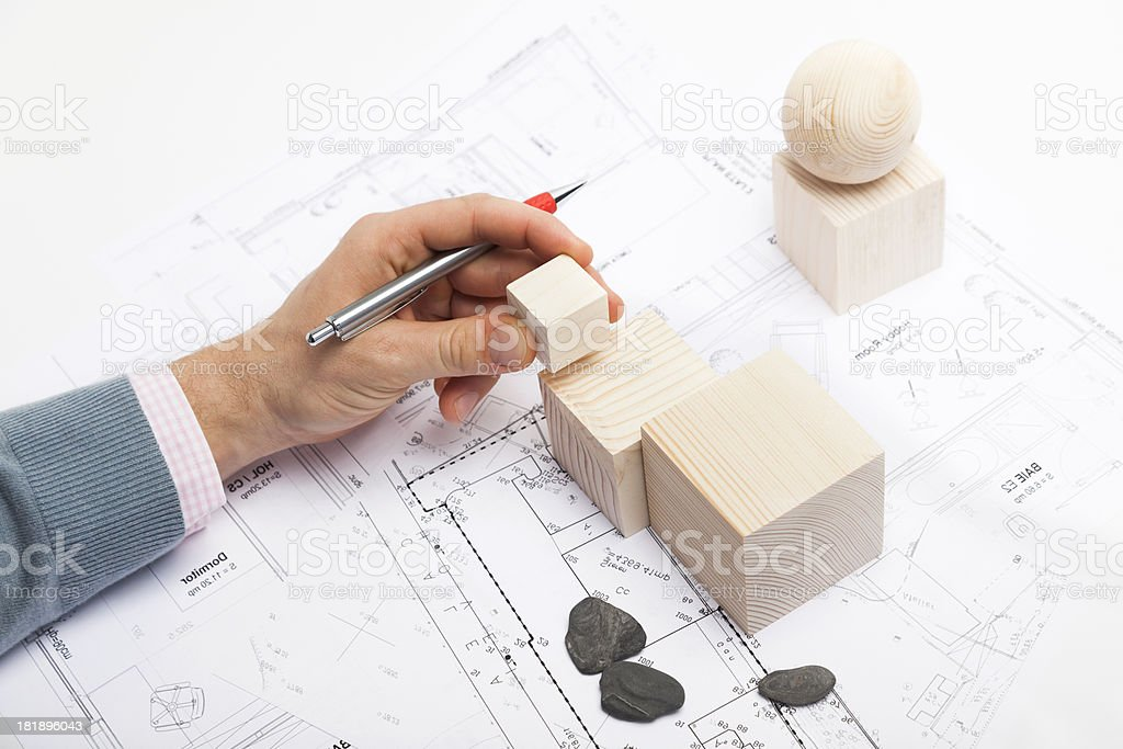 Architect at Work. Planning with Wooden Shapes. Blueprint. royalty-free stock photo
